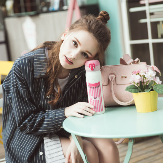 A Female Model posing with BeddyBear Vacuum Flask Classic Prints Series Carousel Design