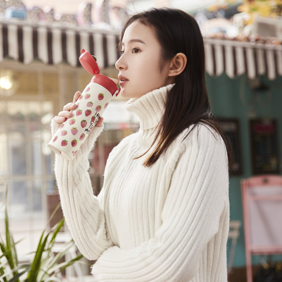 A Female Model drinking from BeddyBear Vacuum Flask Classic Prints Series Strawberry Design