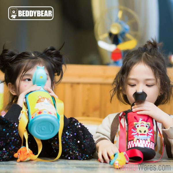 Two Girl Models posing with BeddyBear Children Vacuum Bottles in Tiger and Dragon Design