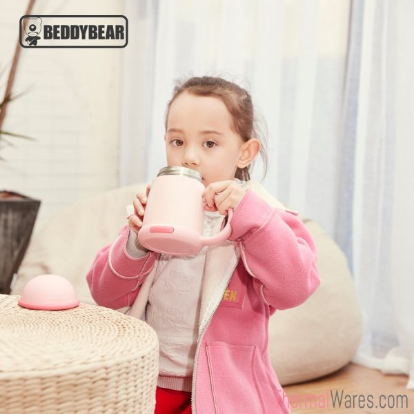 Little Girl posing with BeddyBear Vacuum Mug in Pink Color