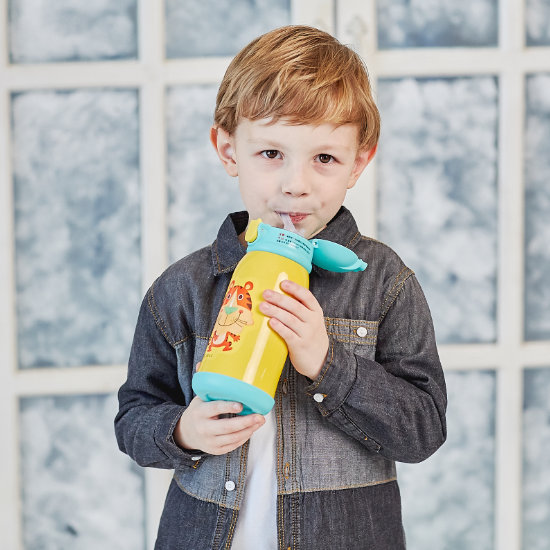 A Young Boy Model sipping from BeddyBear Children Vacuum Bottle Gift Set Series Tiger Design