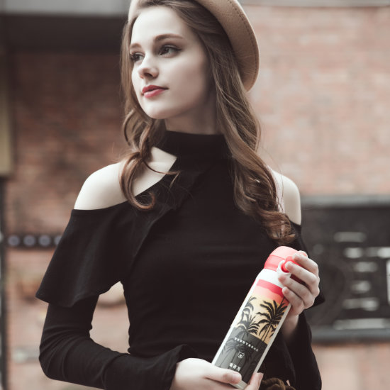 A Female Model posing with BeddyBear Vacuum Flask Classic Prints Series Coconut White Design