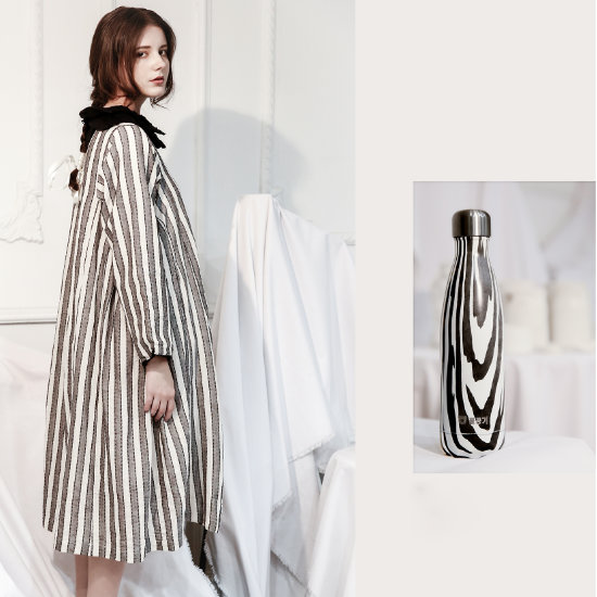 A Female Model posing with BeddyBear Vacuum Bottle Cola Shaped Series Stripes Design