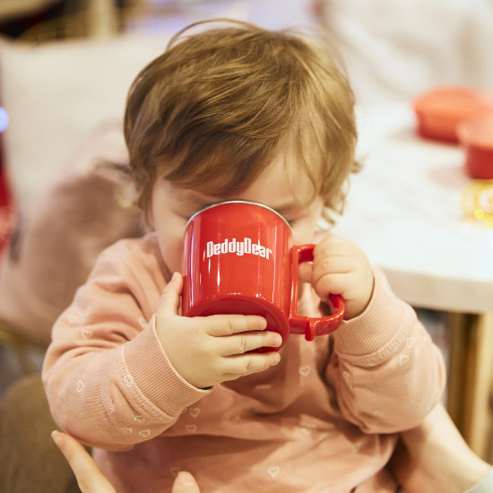 A Toddler Model drinking from BeddyBear Dining Set Red Color Cup