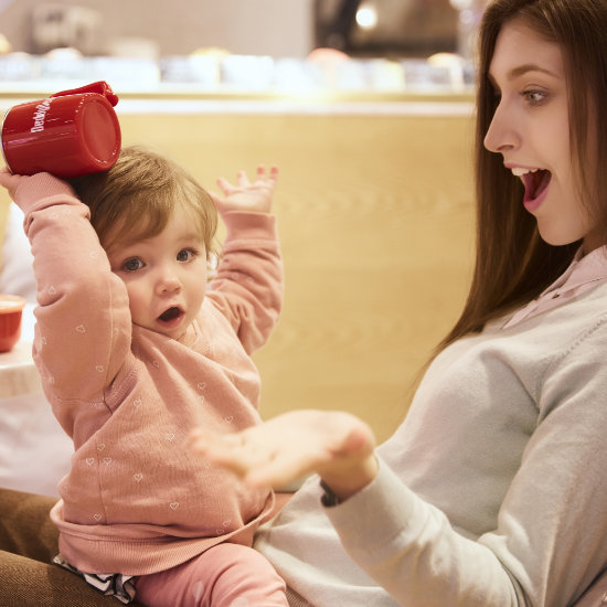 A Mother and Toddler Models posing with BeddyBear Dining Set Red Color Cup