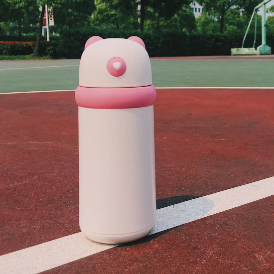 BeddyBear Double Walled Insulation Bottle Pink Color placed on basketball court