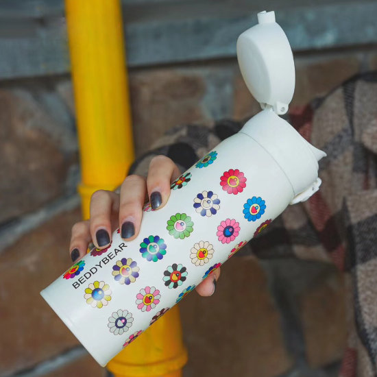 A Model's Hand holding BeddyBear Vacuum Flask Floral Prints Series Small Buds White Design