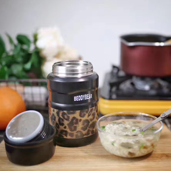 BeddyBear Vacuum Food Container Prints Series Leopard Black Design without cap and a bowl of porridge beside it