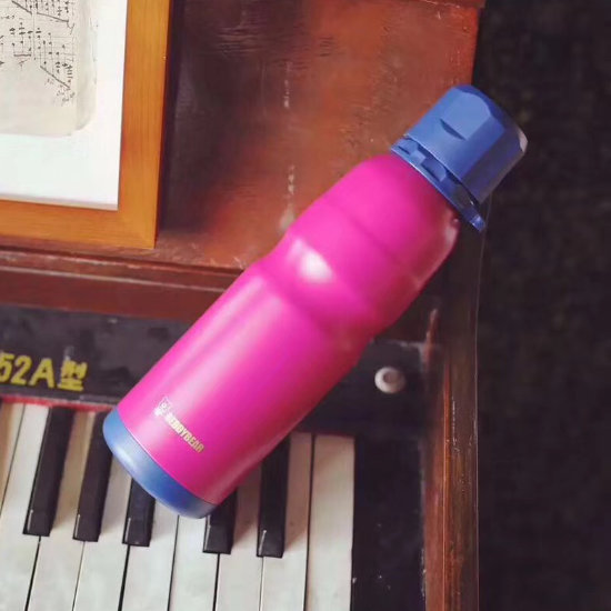 BeddyBear Sports Vacuum Bottle Red Color on a piano